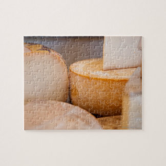 Selective focus photograph of cheeses in cheese jigsaw puzzle