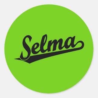Selma script logo in black round sticker