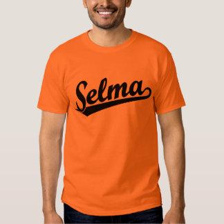 Selma script logo in black shirt