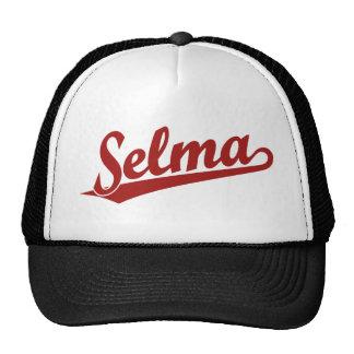 Selma script logo in red cap