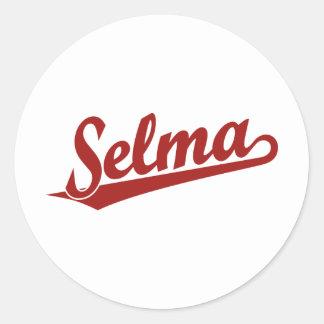 Selma script logo in red round sticker