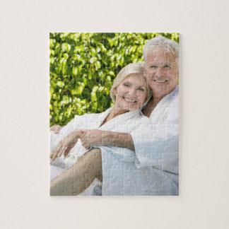Senior Caucasian couple in robes in spa. Puzzle