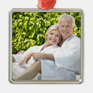Senior Caucasian couple in robes in spa. Silver-Colored Square Decoration