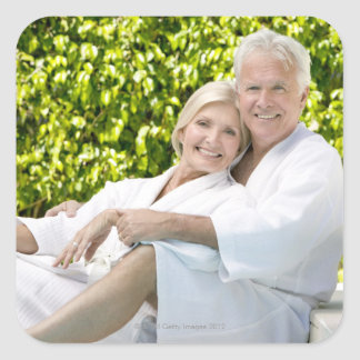 Senior Caucasian couple in robes in spa. Square Sticker