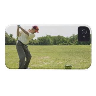 Senior golfer hitting practice balls at a range iPhone 4 Case-Mate cases