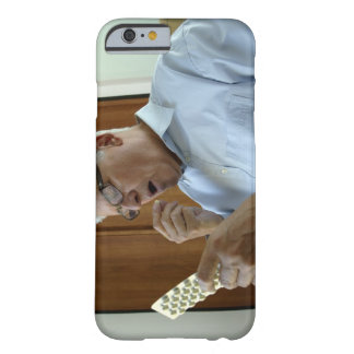 Senior man taking pill barely there iPhone 6 case