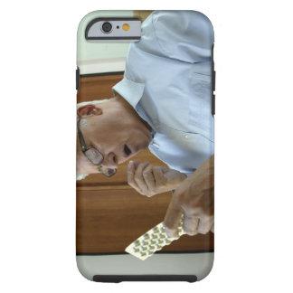 Senior man taking pill tough iPhone 6 case