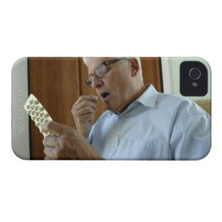 Senior man taking pill iPhone 4 cover