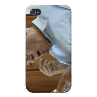 Senior man taking pill iPhone 4 case