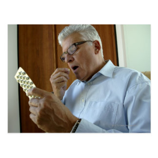 Senior man taking pill postcard