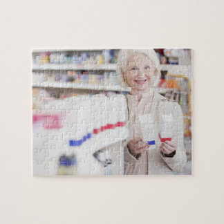 Senior woman comparing packages in drug store jigsaw puzzle