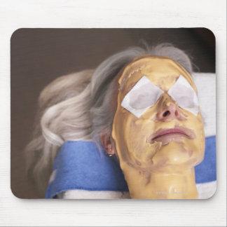 Senior woman having spa treament mouse pad