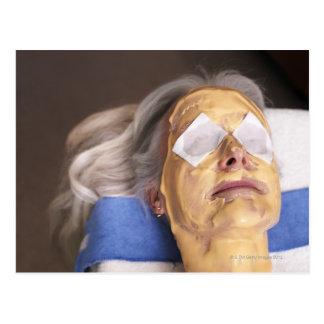 Senior woman having spa treament postcard