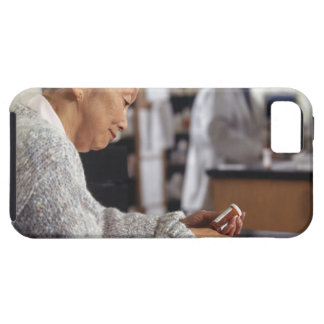 Senior woman in pharmacy reading medicine bottle iPhone 5 case