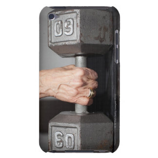 Senior woman lifting weights iPod touch case