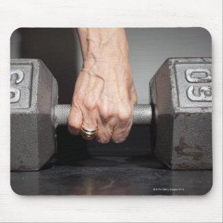 Senior woman lifting weights mouse pad