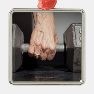 Senior woman lifting weights Silver-Colored square decoration