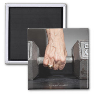 Senior woman lifting weights square magnet