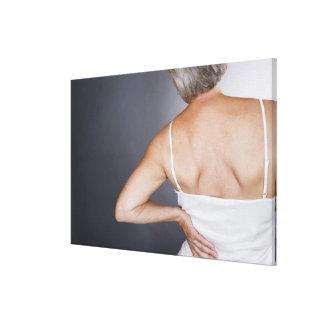 Senior woman with backache 2 canvas print