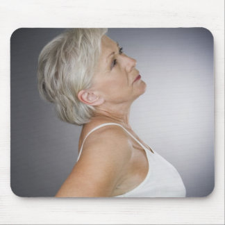 Senior woman with backache mouse pad