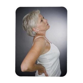 Senior woman with backache rectangular photo magnet