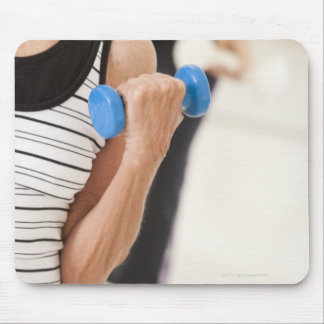 Seniors exercising with dumbbells in a health mouse pad