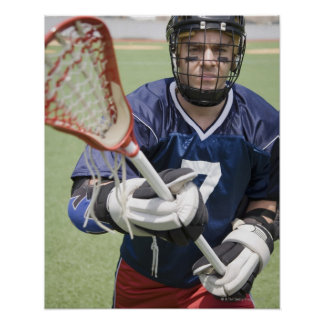 Serious lacrosse player holding crosse poster
