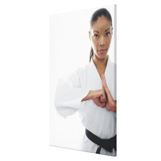 Serious woman doing martial arts canvas print