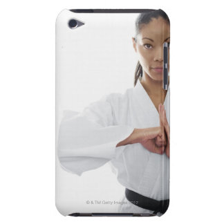 Serious woman doing martial arts iPod Case-Mate case
