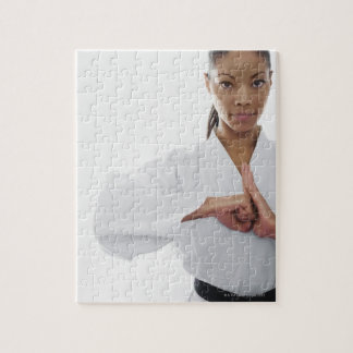Serious woman doing martial arts puzzle