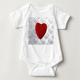 Serrated sheet background with heart baby bodysuit