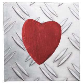 Serrated sheet background with heart napkin