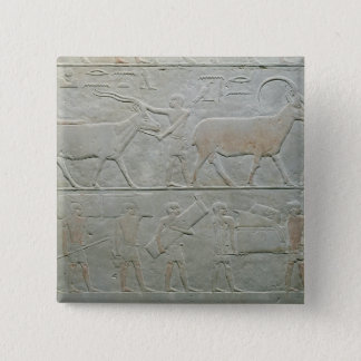 Servants driving an oryx and an antelope 15 cm square badge