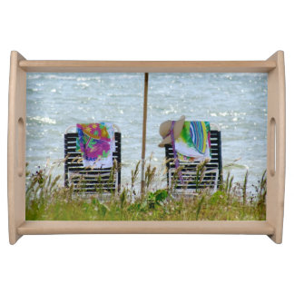 Serving tray with beach chairs and umbrella.