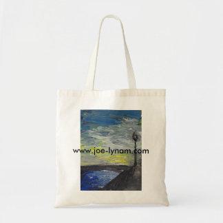Setting sun over river tote bag