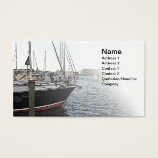 several sail boats docked business card