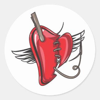 sewn up angel heart round sticker