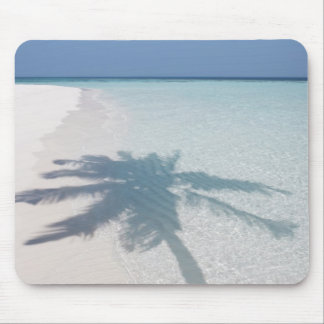 Shadow of a palm tree on a deserted island beach mouse pad