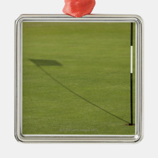 shadow of golf flag on golf course green Silver-Colored square decoration