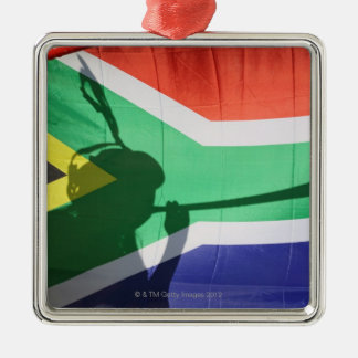 Shadow of soccer supporter blowing vuvuzela, christmas ornament