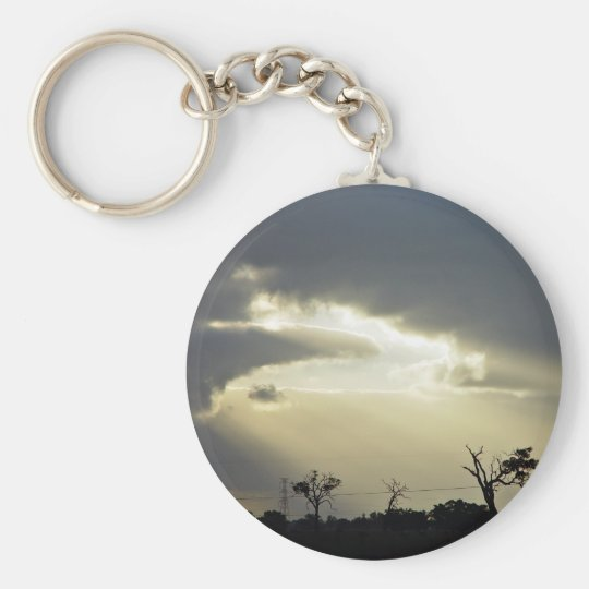 Shafts of sunlight through clouds basic round button key ring
