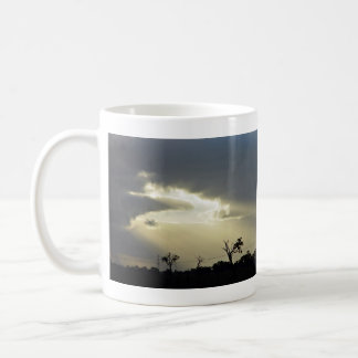 Shafts of sunlight through clouds basic white mug