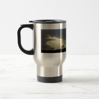 Shafts of sunlight through clouds stainless steel travel mug