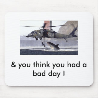 Shark attacks helicopter. mouse mat
