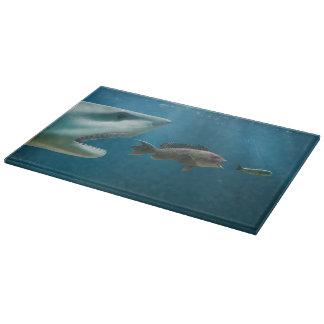 Shark chasing sea bass chasing juvenile cutting board