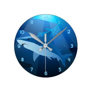 Sharks swimming round clock