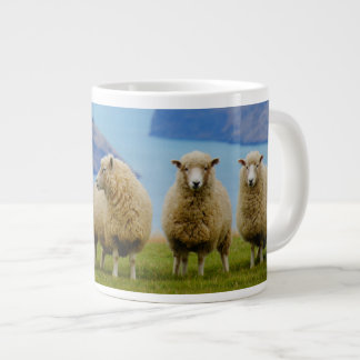 Sheep in row with blue ocean background jumbo mug