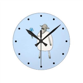 Sheep on Blue Background. Round Clock