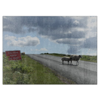 Sheep on road cutting board