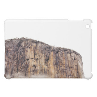 Sheer cliff rising above clouds iPad mini cover